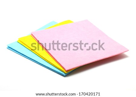Multi colored cleaning cloths isolated on white background - stock photo