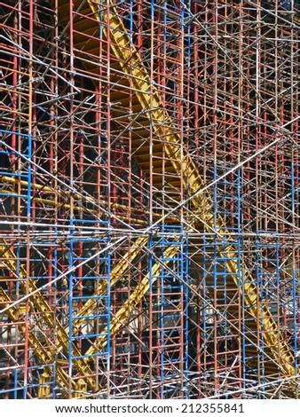 Multi-colored construction scaffolding. - stock photo