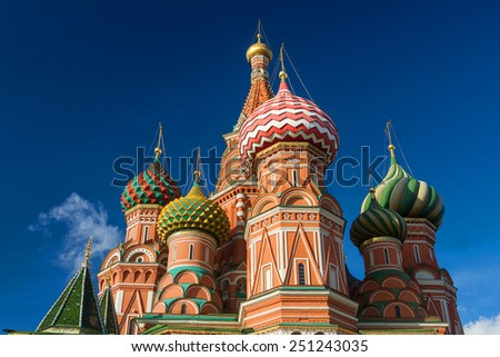 Multi-colored domes of the main Orthodox church in Moscow - St. Basil's Cathedral, a bright autumn day