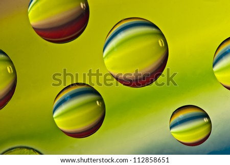 Multi-colored drops of water. Macro photography in the studio. - stock photo