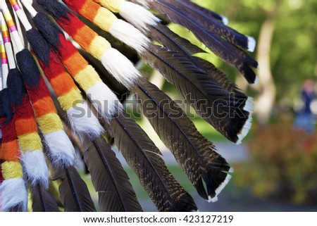 Multi-colored feathers of an Indian national headdress close up - stock photo