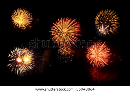 Multi-colored fireworks bursts on black night sky - stock photo