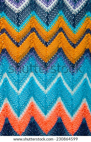 multi colored handmade knitted pattern - stock photo