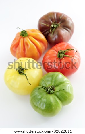 Multi colored heirloom tomatoes isolated on white background - stock photo