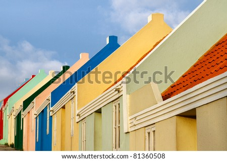 Multi colored houses in the island of Curacao in the Caribbean - stock photo
