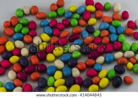 Multi-colored jelly beans, lying on a light