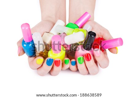 Multi-colored jelly sweets in the hands with a bright nail polish - stock photo