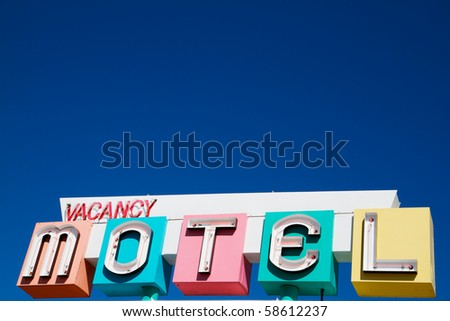 Multi-colored neon Motel and vacany sign in a 1950s style - stock photo