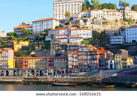 Multi-colored old houses around Ribeyr, Porto, Portugal - stock photo