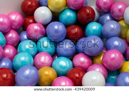 Multi-colored opalescent candies background