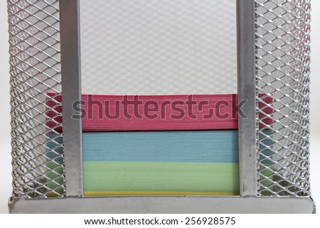 Multi-colored paper for notes in the stand - stock photo