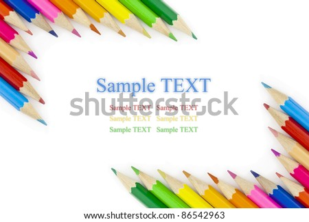 Multi colored pencils in a corner on a white background with space for text