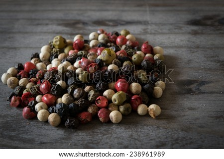 Multi Colored Pepper Corns on a Wooden Table