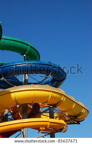 Multi-colored pipes of an aquapark against the blue sky