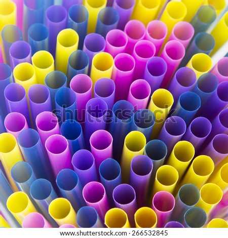 Multi colored plastic drinking straws - stock photo