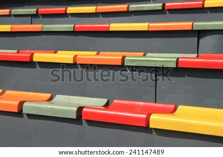 Multi colored seats on the stadium - stock photo