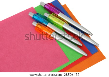 Multi colored sheets of paper and pens