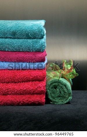 Multi-colored stack of towels - stock photo