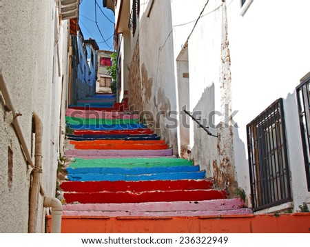 Multi colored steps in Turkish village street. - stock photo