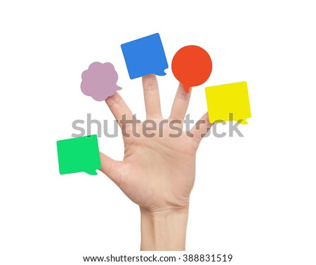 Multi-colored stickers on the fingers of the hand. Isolated on white background.