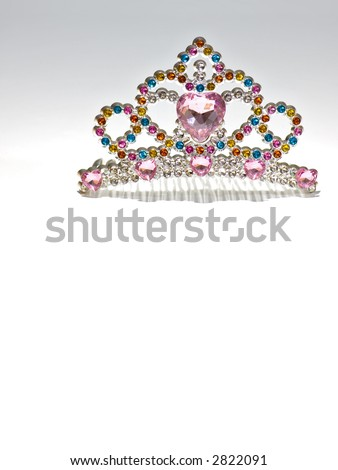 Multi colored tiara isolated on gradient background. Costume jewelry. - stock photo