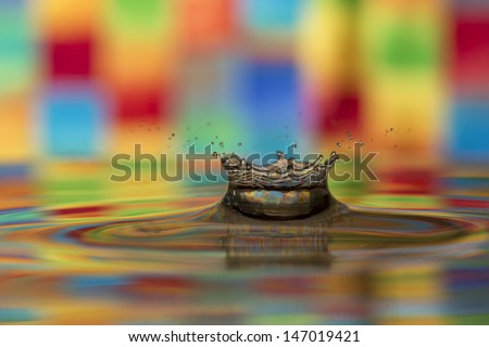 Multi-colored tie dye water splash - stock photo