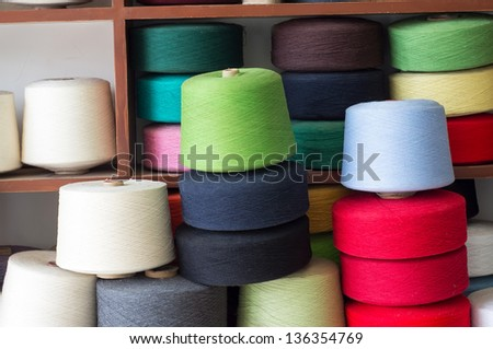 Multi-colored yarn on the show - stock photo
