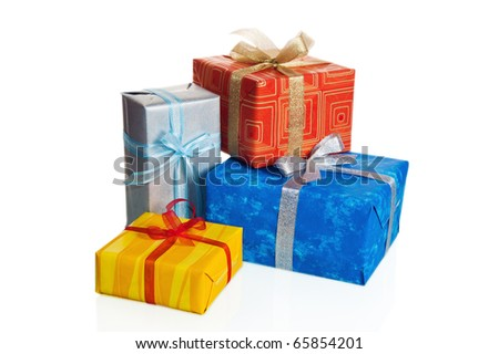 Multi-coloured boxes with gifts, it is isolated on white - stock photo