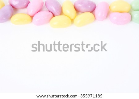 Multi coloured candies on a white background - stock photo