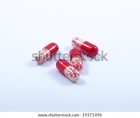 Multi-coloured capsules on a white background