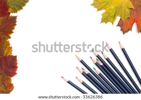 Multi-coloured pencils and autumn leaves on a white background. We draw autumn. - stock photo