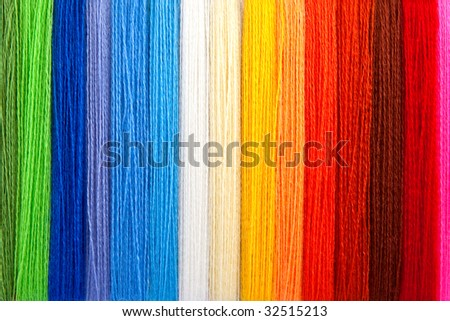 Multi-coloured threads of a wool - stock photo