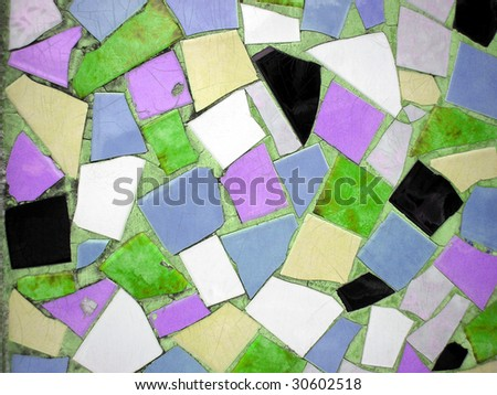 Multi coloured tiles forming an opus incertum pavement useful as a background