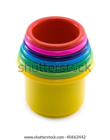 Multi-coloured toy buckets on a white background