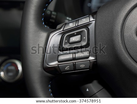 Multi control buttons on the steering wheel of the luxury modern car. - stock photo