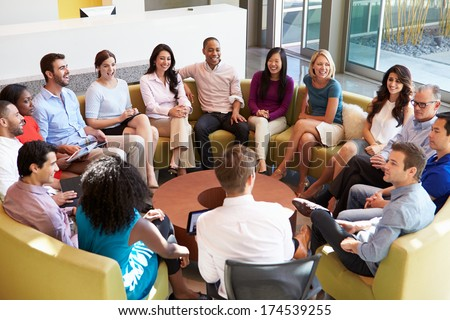 Multi-Cultural Office Staff Sitting Having Meeting Together - stock photo