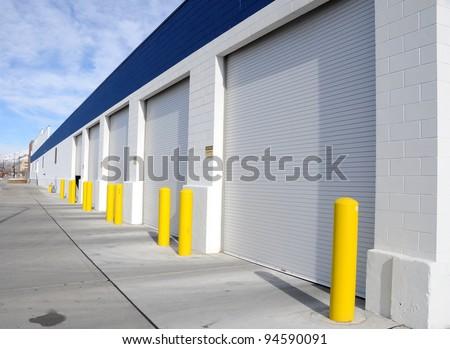Multi-Door Garage in Industrial Area - stock photo