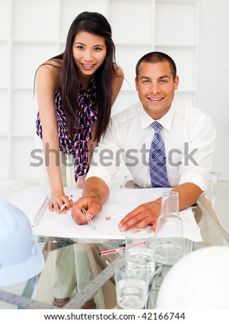 Multi-ethnic architect co-workers disscussing a project in a meeting - stock photo