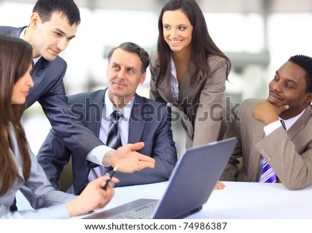 Multi ethnic business executives at a meeting discussing a work - stock photo