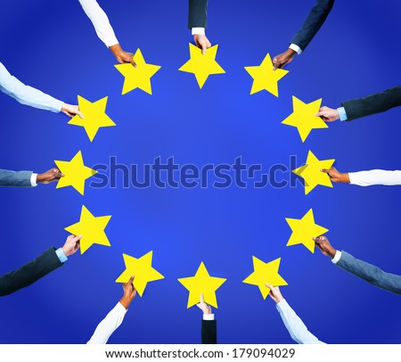 Multi-Ethnic Business Hands Holding Stars To Form The European Union Flag - stock photo