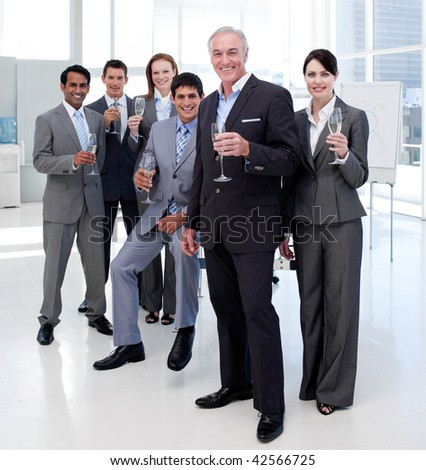 Multi-ethnic business people celebrating a success with Champagne - stock photo