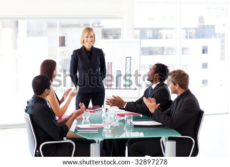 Multi-ethnic business people clapping in a presentation - stock photo