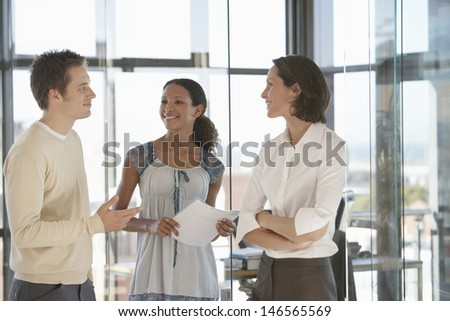 Multi ethnic business people communicating in office - stock photo