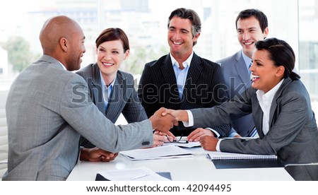 Multi-ethnic business people greeting each other in a meeting - stock photo