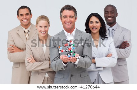 Multi-ethnic business people holding a molecule model. Science and business concept - stock photo