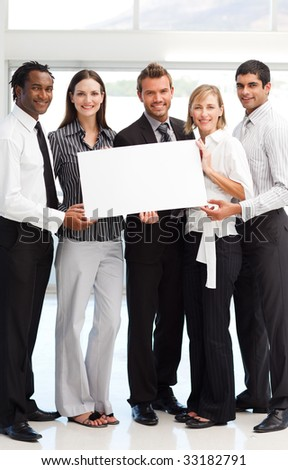 Multi-ethnic business people showing a big white card