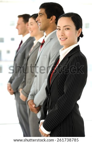 Multi ethnic business people standing in a row. Selective focus on the Asian woman on foreground. - stock photo