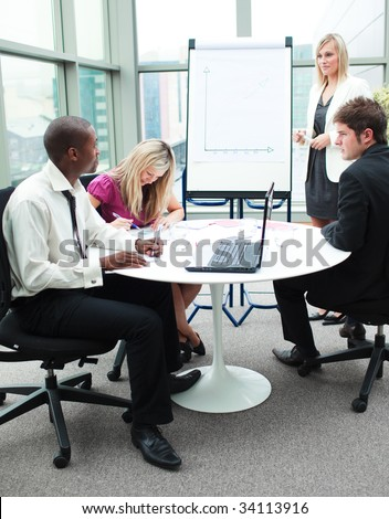Multi-ethnic business people working together in a presentation - stock photo