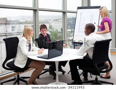 Multi-ethnic business people working together in an office - stock photo