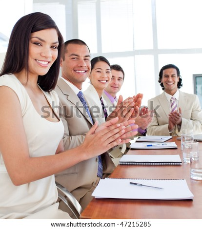 Multi-ethnic business team applauding after a conference in a company - stock photo